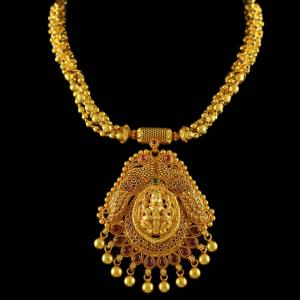 Gold Plated Lakshmi with Peacock Necklace Studded red Onyx Stones