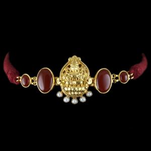 Gold Plated God Design Vanki Bajubgand Studded Red Onyx And Pearls