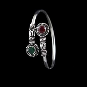 OXIDIZED SILVER FLEXIBLE BANGLE WITH RUBY AND EMERALD
