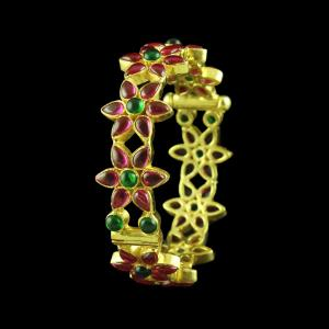 GOLD PLATED RED AND GREEN CORUNDUM FLORAL BANGLE