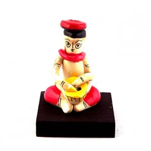 CLAY DOLL SITTING MUSICIAN