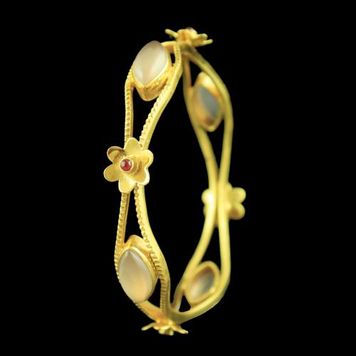 GOLD PLATED FLORAL DESIGN ONYX BANGLE