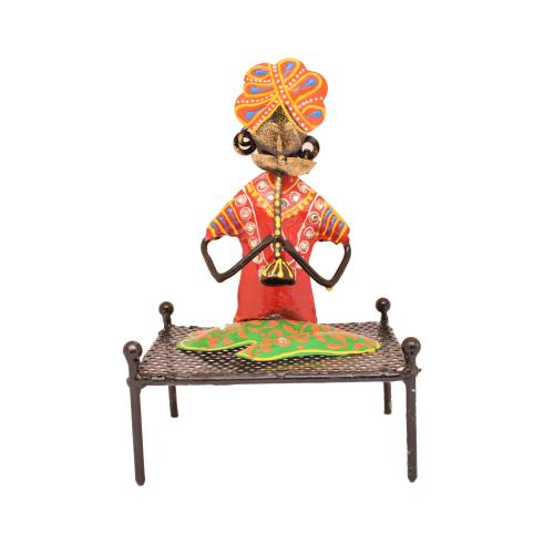 IRON PAINTED MUSICIAN SITTING ON TABLE