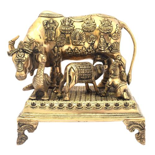 BRASS ANTIQUE COW AND CALF STANDING ON BASE WITH KRISHNA AND PEACOCK